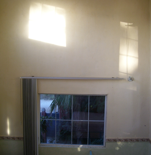 window and light on the tall walls