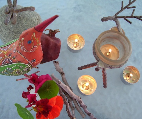 five tealight candles, flowers, orange metal bird