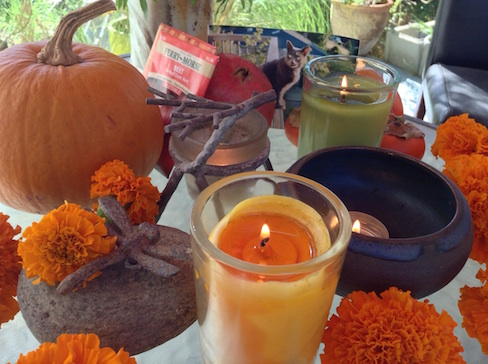 my altar with candles and pumpkin and marigolds
