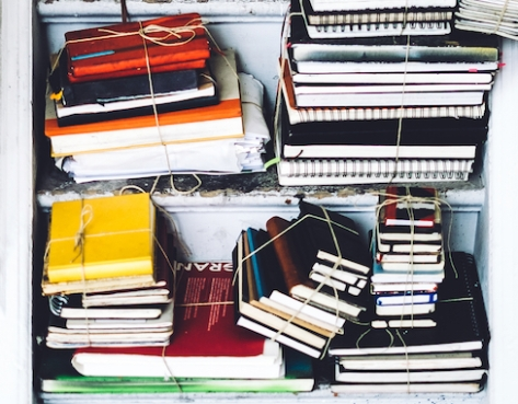 shelves of used notebooks tied in bundles
